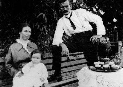 Percy James and Francis Matilda Carseldine with eldest son Andrew Joseph on Grandma's knee. Photo in the garden at Fairfield about October 1914.